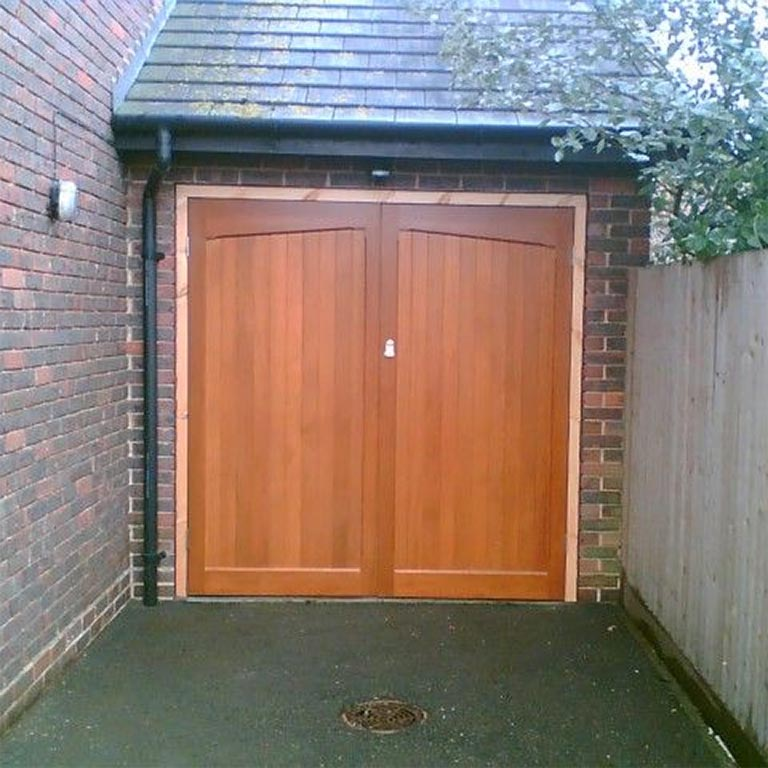 Side hinge garage doors