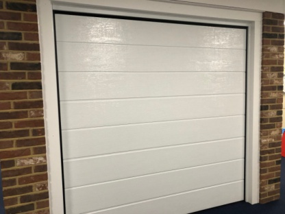 Novoferm 20mm insulated Large Rib Woodgrain automated sectional garage door